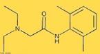 Representação da molécula da Lidocaína ou xilocaína®, 2-(dietilamino)-N-(2,6dimetilfenil)acetamido, que é um fármaco do grupo dos Antiarrítmicos da classe I (subgrupo 1B), e dos anestésicos locais que é usado no tratamento da arritmia cardíaca e da dor local (como em operações cirúrgicas). É pouco tóxica. <br/><br/> Palavras-chave: Lidocaína. Anestésico. Xilocaína.